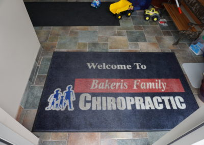 Entryway floor mat at Bakeris Family Chiropractic in Coralville, Iowa